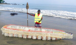 African Local Sees Waste Plastic Bottles Clogging Waterway–So He Uses Them to Make 'Eco-Boats'