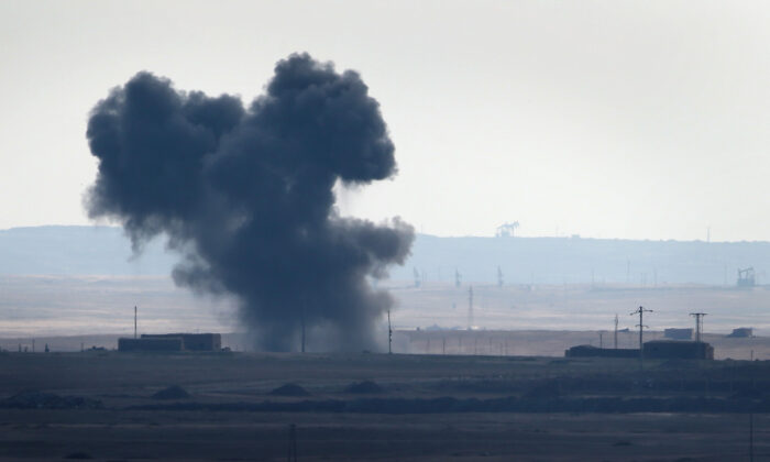 An airstrike explosion is seen Syria in a file photo. (John Moore/Getty Images)