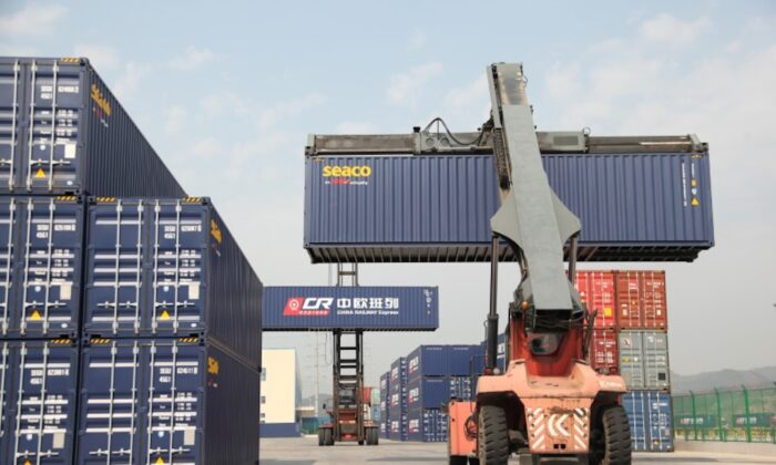 Container handlers transport containers at the railway port in Yiwu, Zhejiang Province, China on April 15, 2017. (Reuters)