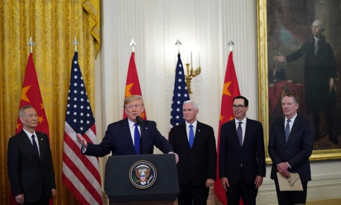 "U.S. President Donald Trump stands between Chinese Vice Premier Liu He, U.S. Vice President Mike Pence, Treasury Secretary Steven Mnuchin and U.S. Trade Representative Robert Lighthizer prior to signing ""phase one"" of the U.S.-China trade agreement with Liu in the East Room of the White House in Washington, D.C., on Jan. 15, 2020. (Kevin Lamarque/Reuters)"