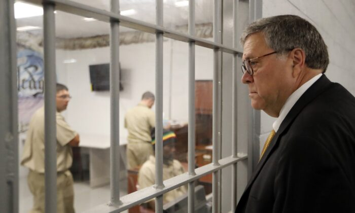 Attorney General William Barr watches as inmates work in a computer class during a tour of a federal prison in Edgefield, S.C., on July 8, 2019. (John Bazemore/AP Photo)