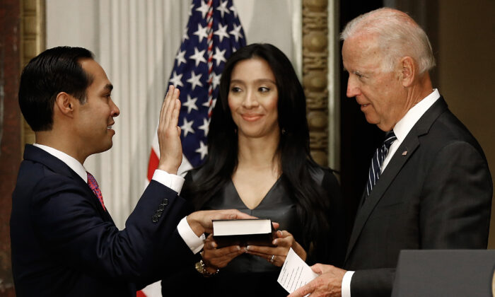 Vice President Joe Biden (R) swears in Secretary of Housing and Urban Development Julian Castro (L) as his wife Erica and daughter Carina look on during a ceremonial swearing in ceremony in the Eisenhower Executive Office Building in Washington on Aug. 18, 2014. (Win McNamee/Getty Images)