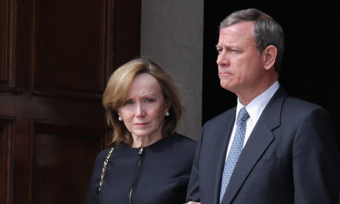 Supreme Court Chief Justice John Roberts (R) and his wife Jane Roberts leave the Basilica of the National Shrine of the Immaculate Conception in Washington on Feb. 20, 2016. (Chip Somodevilla/Getty Images)