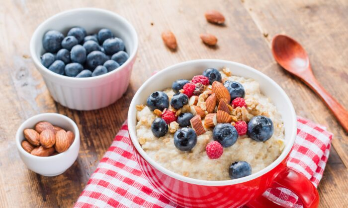 Get your day off to a great start with whole foods including berries, oatmeal, and nuts. (Vladislav Noseek/Shutterstock)