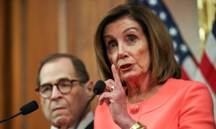 House Speaker Nancy Pelosi (D-Calif.) speaks next to House manager Judiciary Committee Chairman Jerry Nadler (D-N.Y.) in Washington on Jan. 15, 2020. (Leah Millis/Reuters)