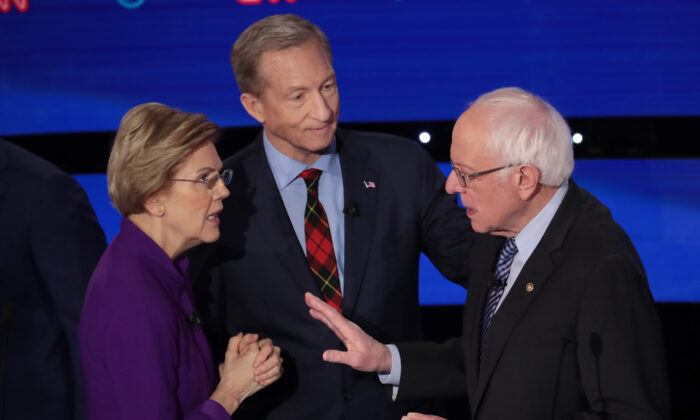 Sen. Elizabeth Warren (D-Mass.) and Sen. Bernie Sanders (I-Vt.) speak as Tom Steyer looks on after the Democratic presidential primary debate at Drake University in Des Moines, Iowa on Jan. 14, 2020. Six candidates out of the field qualified for the first Democratic presidential primary debate of 2020. (Scott Olson/Getty Images)