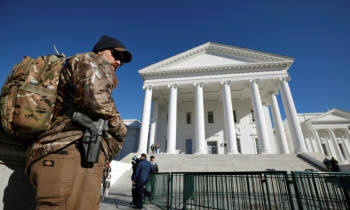 A gun rights activist carries his handgun in a hip holster outside the Virginia State Capitol building as the General Assembly prepares to convene in Richmond, Virginia, on Jan. 8, 2020. (REUTERS/Jonathan Drake)
