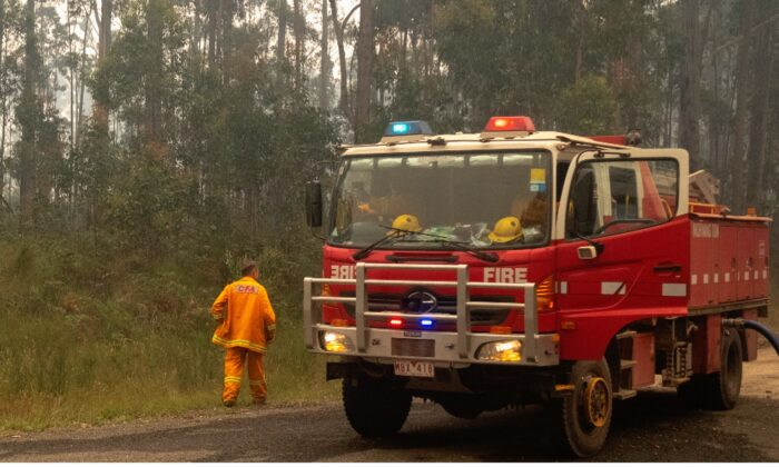 Fire trucks refills with water along the Princes Highway near Mallacoota, Australia, on Jan. 15, 2020. (Luis Ascui/Getty Images)