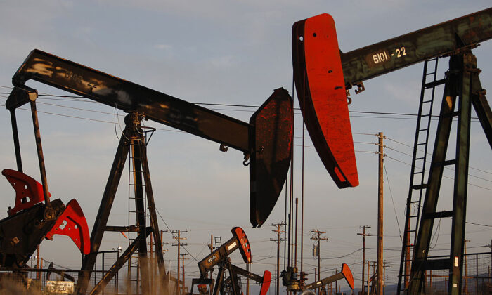 Pump jacks and wells are seen in an oil field on the Monterey Shale formation where hydraulic fracturing, or fracking, is used to extract gas and oil near McKittrick, Calif., on March 23, 2014. (David McNew/Getty Images)