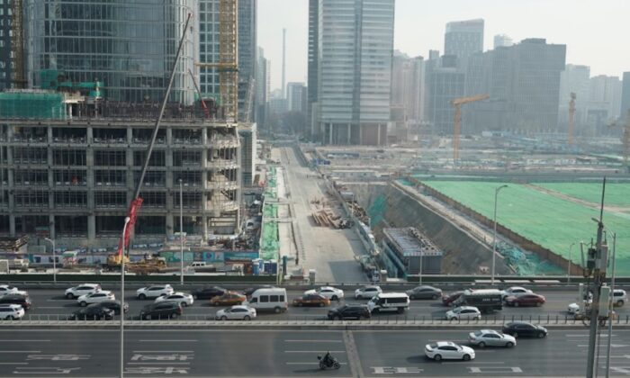 Vehicles drive past construction sites in Beijing's central business area, China on Jan. 17, 2020. (Jason Lee/Reuters)