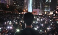 Hong Kong Protester Arrested in China on Charges of 'Soliciting Prostitution'