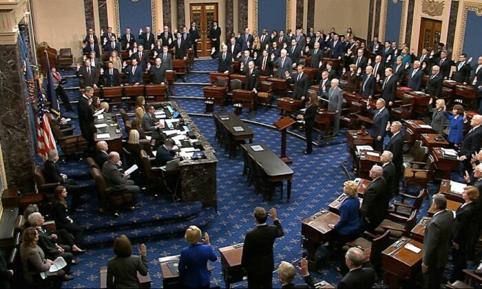 Presiding officer Supreme Court Chief Justice John Roberts swears in members of the Senate for the impeachment trial against President Donald Trump at the U.S. Capitol in Washington, on Jan. 16, 2020. (Senate Television via AP)