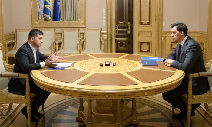 Ukrainian President Volodymyr Zelenskiy, left, talks with Ukraine's Prime Minister Oleksiy Honcharuk in a televised meeting in Kyiv, Ukraine, on Jan. 17, 2020. (Ukrainian Presidential Press Office/AP)