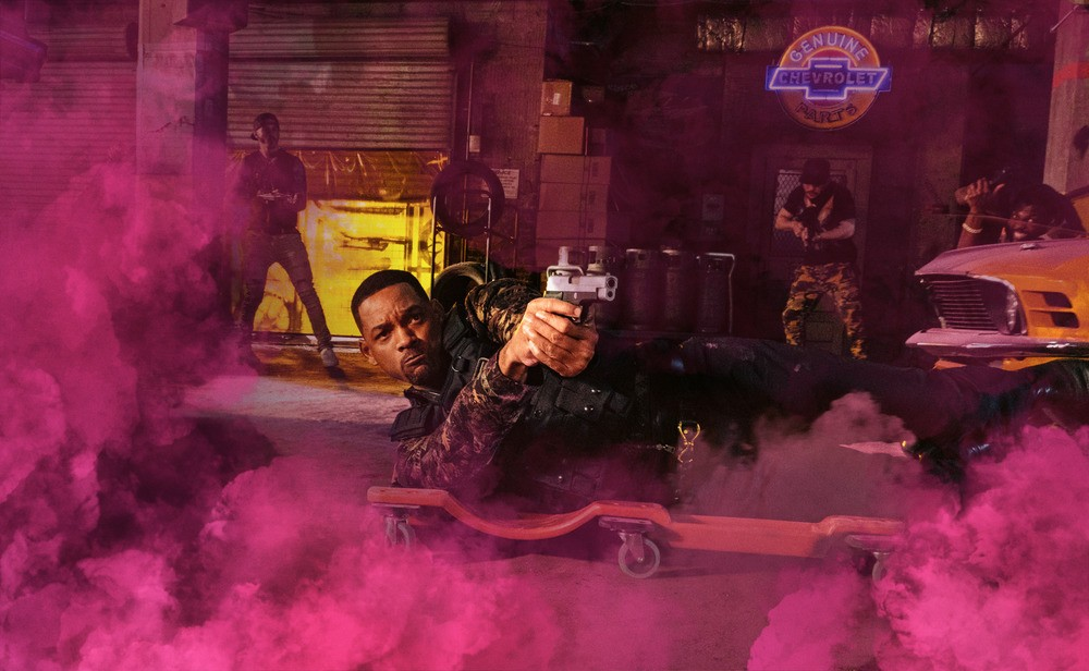 """man on ground with gun and pink smoke in """"Bad Boys For Life."""""""