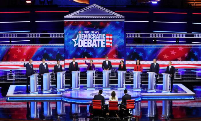 Democratic presidential candidates New York City Mayor Bill De Blasio (L–R), Rep. Tim Ryan (D-Ohio), former housing secretary Julian Castro, Sen. Cory Booker (D-N.J.), Sen. Elizabeth Warren (D-Mass.), former Texas congressman Beto O'Rourke, Sen. Amy Klobuchar (D-Minn.), Rep. Tulsi Gabbard (D-Hawaii), Washington Gov. Jay Inslee, and former Maryland congressman John Delaney take part in the first night of the Democratic presidential debate in Miami, Florida on June 26, 2019.  (Joe Raedle/Getty Images)