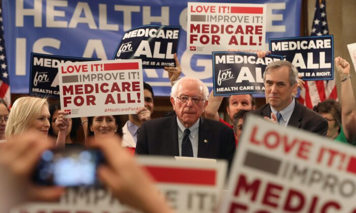 "Sen. Bernie Sanders (I-Vt.) speaks while introducing health care legislation titled the ""Medicare for All Act of 2019"" with Sen. Kirsten Gillibrand (D-N.Y.) and Sen. Jeff Merkley (D-Ore.), during a news conference on Capitol Hill in Washington on April 9, 2019.  Mark Wilson/Getty Images"