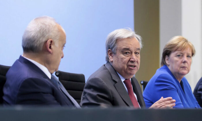 From left, U.N. Envoy for Libya, Ghassan Salame, United Nations Secretary-General Antonio Guterres, and German Chancellor Angela Merkel attend a news conference after the conference on Libya at the chancellery in Berlin, Germany, on Jan. 19, 2020. (Axel Schmidt/Pool Photo via AP)