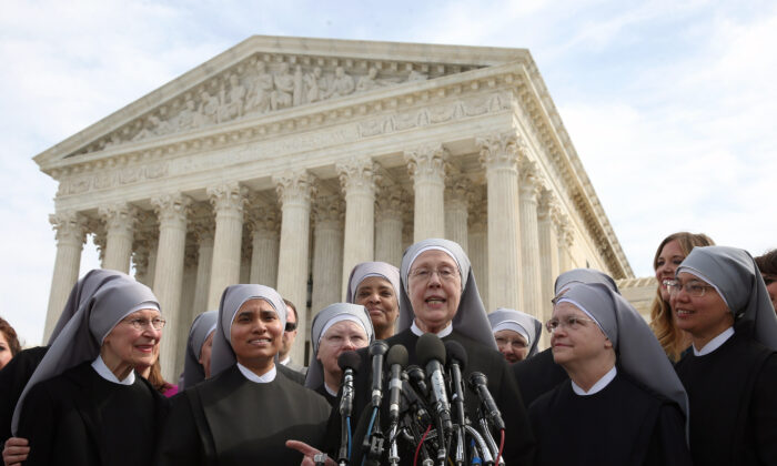 Mother Loraine Marie Maguire, (C), of the Little Sisters of the Poor, speaks to the media after arguments at the U.S. Supreme Court in Washington on March 23, 2016. (Mark Wilson/Getty Images)