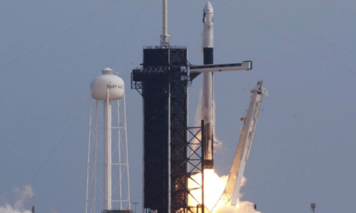 A SpaceX Falcon 9 rocket, carrying the Crew Dragon astronaut capsule, lifts off on an in-flight abort test, a key milestone completion before flying humans in 2020 under NASA's commercial crew program, from the Kennedy Space Center in Cape Canaveral, Fla., on Jan. 19, 2020. (Joe Skipper/Reuters)