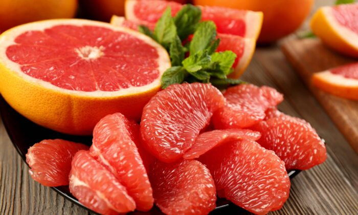 While we may be tempted to skin our grapefruit wedges to improve the flavor, the white part of the rind and the skin of the individual wedges contain health-promoting properties. (Africa Studio/Shutterstock)