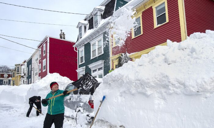 Residents dig out their car in St. John's on Jan. 19, 2020. The City of St. John's declared a state of emergency in the aftermath of the major winter storm that hit the Newfoundland and Labrador capital, leaving businesses closed and vehicles off the road. (The Canadian Press/Andrew Vaughan)