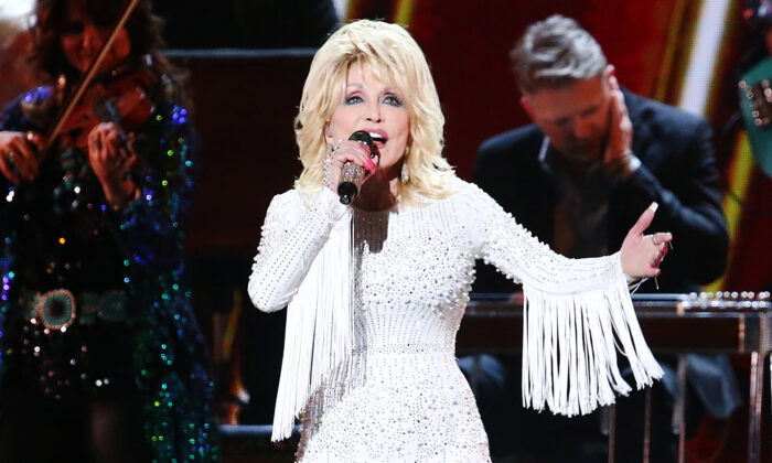 Dolly Parton performs onstage during the 53rd annual CMA Awards at the Bridgestone Arena in Nashville, Tenn., on Nov. 13, 2019. (Terry Wyatt/Getty Images)