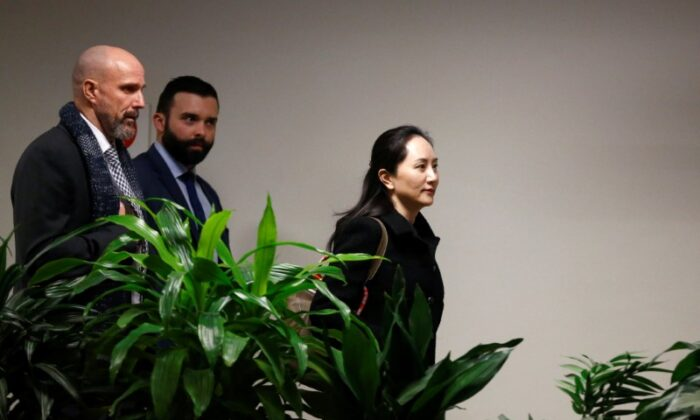 Huawei Chief Financial Officer Meng Wanzhou leaves B.C. Supreme Court for lunch break during the first day of her extradition trial in Vancouver, British Columbia, Canada, on Jan. 20, 2020.  (REUTERS/Lindsey Wasson)