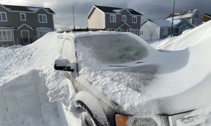 Pile of snow is pictured outside a house in St John's, Newfoundland And Labrador, Canada January 18, 2020. (J. David Mitchell/via Reuters)