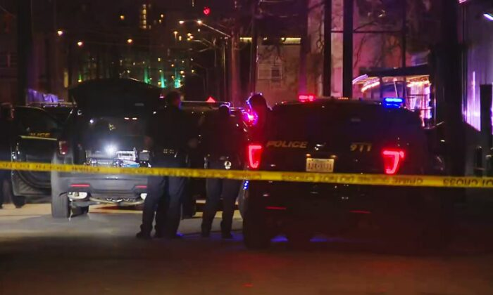 San Antonio police officers work the scene of a deadly shooting at the Ventura, a music venue in San Antonio, Texas, on Jan. 19, 2020. (KSAT via AP)