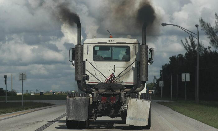 Smoke pours from the exhaust pipes on a truck in Miami, Florida, on Nov. 5, 2019. (Joe Raedle/Getty Images)