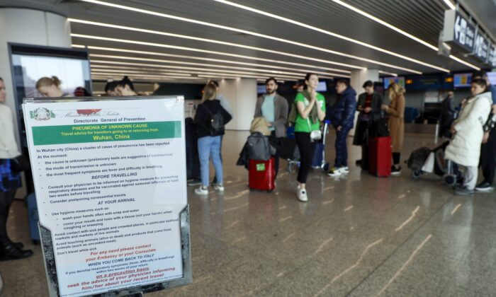 A notice explaining precautions to be taken by people traveling to Wuhan, China, at a terminal of the Rome Fiumicino International Airport in Italy on Jan. 21, 2020. (AP Photo/Gregorio Borgia)