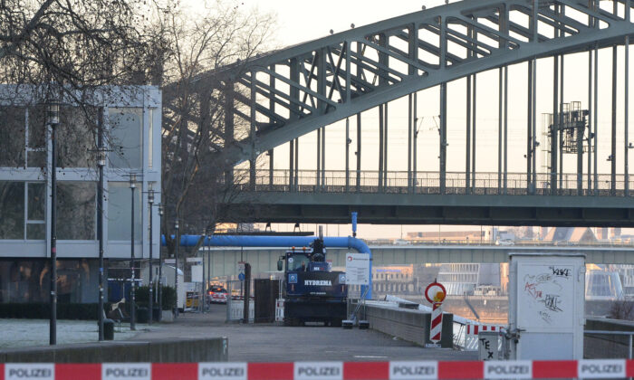 The excavator that uncovered the bomb stands in front of the Hohenzollern Bridge in Cologne, Germany, on Jan. 21, 2020. (Roberto Pfeil/dpa via AP)