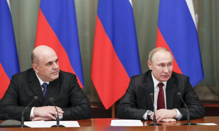 Russian President Vladimir Putin (R) and new Russian Prime Minister Mikhail Mishustin attend a new cabinet meeting in Moscow, Russia, on Jan. 21, 2020. (Dmitry Astakhov, Sputnik, Government Pool Photo via AP)