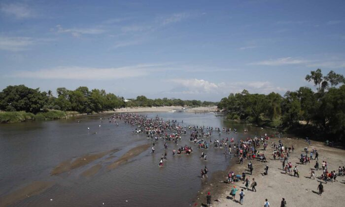 Central American migrants cross the Suchiate River by foot from Tecun Uman, Guatemala, to Mexico, on Jan. 20, 2020. (Moises Castillo/(AP Photo)
