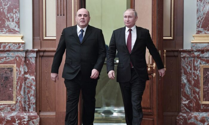 Russian President Vladimir Putin, right, and new Russian Prime Minister Mikhail Mishustin arrive at a new cabinet meeting in Moscow, Russia, on Jan. 21, 2020. (Alexei Nikolsky, Sputnik, Kremlin Pool Photo via AP)