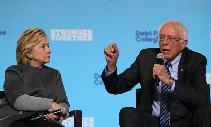 Then-Democratic presidential nominee Hillary Clinton, left, looks on as Sen. Bernie Sanders (I-Vt.) speaks during a campaign rally at University of New Hampshire in Durham, New Hampshire, on Sept. 28, 2016. (Justin Sullivan/Getty Images)