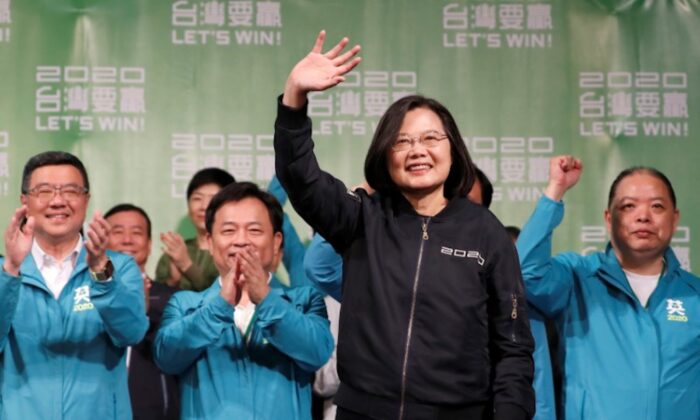 Incumbent Taiwan President Tsai Ing-wen waves to her supporters after her election victory at a rally, outside the Democratic Progressive Party (DPP) headquarters in Taipei, Taiwan on Jan. 11, 2020. (Tyrone Siu/Reuters)