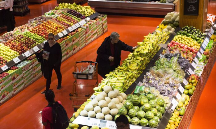 """People shop at a Loblaws store in Toronto on May 3, 2018. Food, patriotism, and marketing will soon converge in a """"Buy Canadian Promotion Campaign"""" sponsored by taxpayers. (The Canadian Press/Nathan Denette)"""