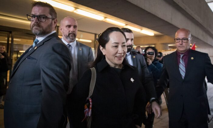 Huawei executive Meng Wanzhou, who is out on bail and remains under partial house arrest, leaves the B.C. Supreme Court in Vancouver on Jan. 21, 2020. (The Canadian Press/Darryl Dyck)
