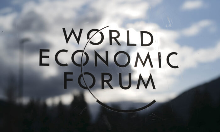 The logo of the World Economy Forum is displayed on a door at the Congress Centre in Davos, Switzerland, on Jan. 19, 2020.  Markus Schreiber/AP Photo