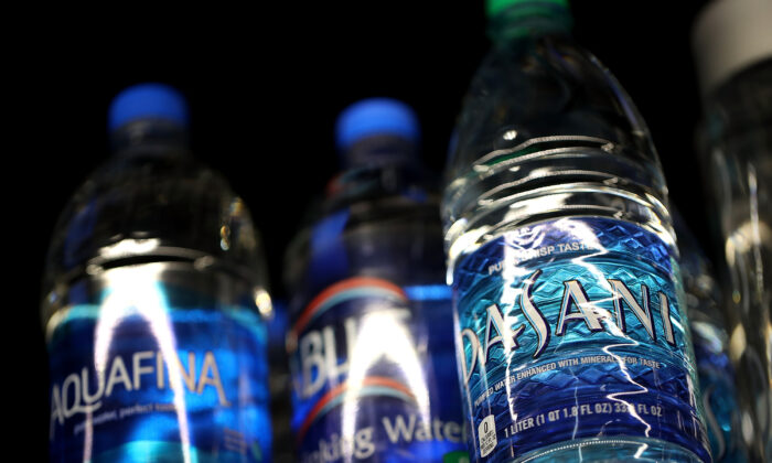 Bottles of water are displayed on a shelf at a convenience store in San Rafael, Calif., on March 16, 2018. (Justin Sullivan/Getty Images)