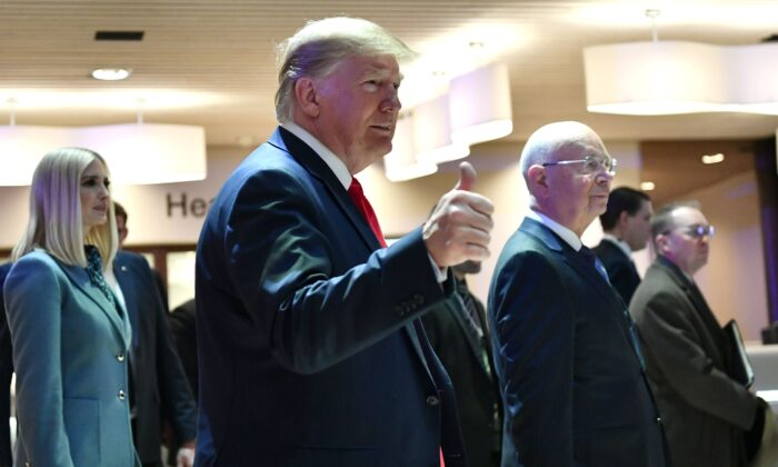 President Donald Trump (C) gestures flanked by her daughter White House Senior Advisor Ivanka Trump and World Economic Forum (WEF) founder and executive chairman Klaus Schwab, as they arrive at the Congress center during the WEF annual meeting in Davos on Jan. 22, 2020.  Fabrice Coffrini/AFP via Getty Images