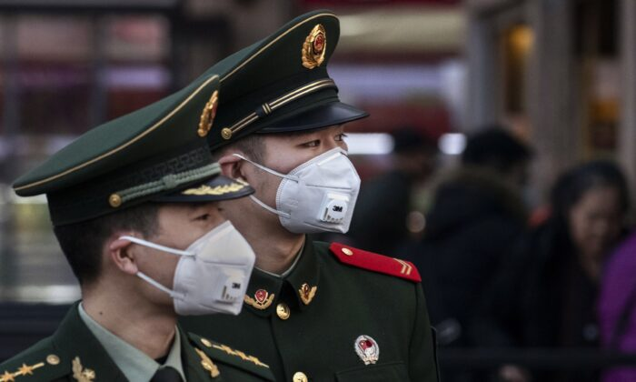 Chinese police officers wear protective masks at Beijing Station in Beijing, China on Jan. 22, 2020. (Kevin Frayer/Getty Images)