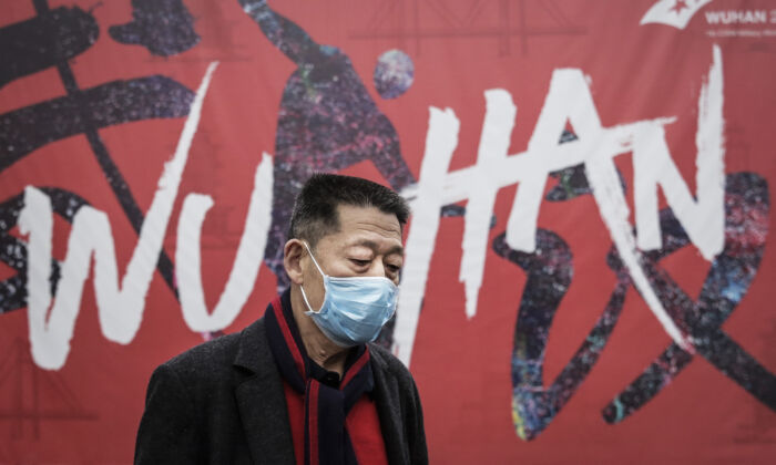 A man wears a mask while walking in the street in Wuhan, China on Jan. 22, 2020. (Getty Images)
