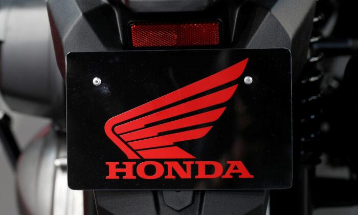 Honda Motor Co. logo is seen at the Paris auto show, in Paris, France on Oct. 4, 2018. (Benoit Tessier/Reuters)