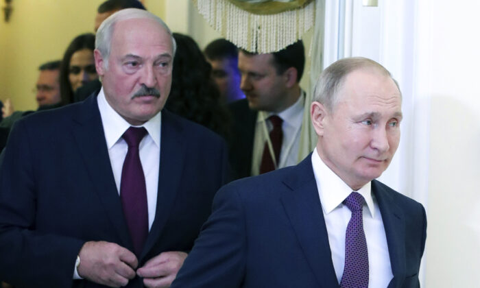 Russian President Vladimir Putin (R) and Belarusian President Alexander Lukashenko walk before a meeting of the Supreme Eurasian Economic Council in St. Petersburg, Russia, on Dec. 20, 2019. (Mikhail Klimentyev, Sputnik, Kremlin Pool Photo via AP, File)