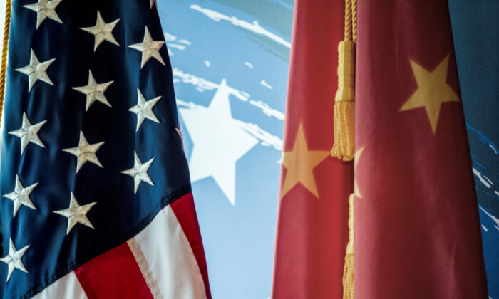 The Chinese and U.S. national flags on display during a promotional event in Beijing on Jun. 30, 2017. (Fred Dufour/AFP via Getty Images)