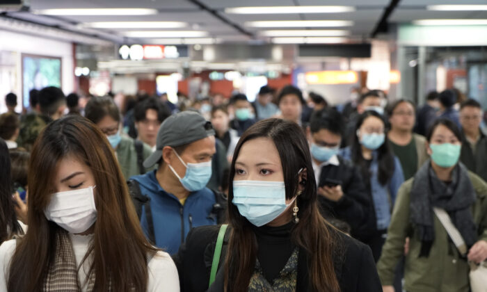 Passengers wear masks to prevent an outbreak of a new coronavirus in a subway station, in Hong Kong on Jan. 22, 2020. (Kin Cheung/AP Photo)