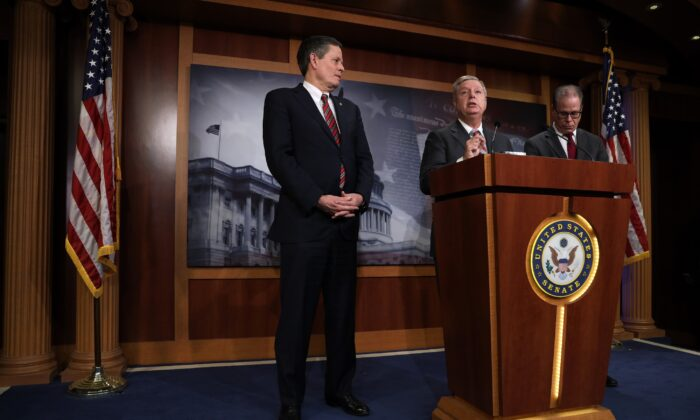 Sen. Lindsey Graham (R-S.C.) speaks as Sen. Steve Daines (R-Mont.), left, and Sen. Mike Braun (R-Ind.) listen during a news conference on the Senate impeachment trial against President Donald Trump at the U.S. Capitol in Washington on 22, 2020. (Alex Wong/Getty Images)