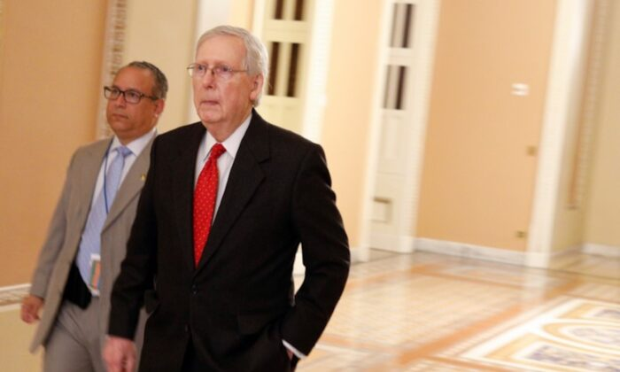 U.S. Senate Majority Leader Mitch McConnell (R-KY) enters the Senate Floor during U.S. President Donald Trump's Senate Impeachment Trial in Washington, on Jan. 21, 2020. (Reuters/Tom Brenner)